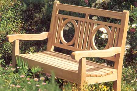 This bench is reminiscent of early 20th century Frank Lloyd Wright Design.